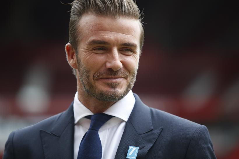 [08:51] David Beckham poses for photographers at Old Trafford