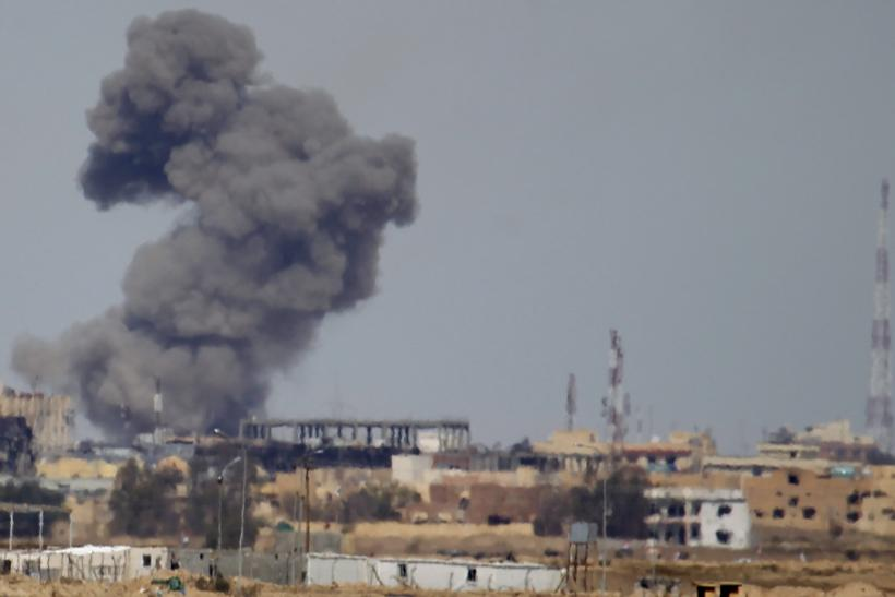 Smoke rises above Tikrit, Iraq after a U.S. airstrike against the Islamic State group.