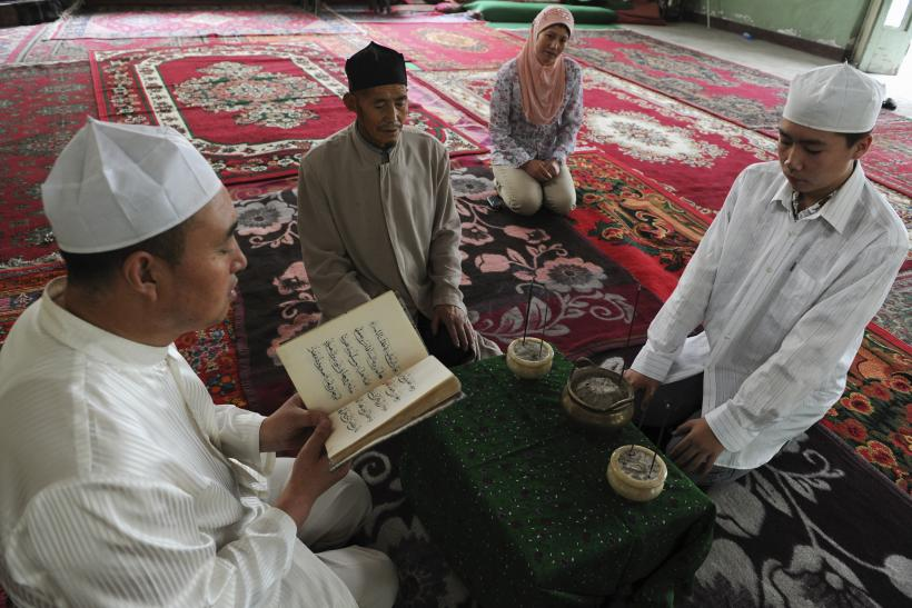 People from the Hui minority read from the Koran