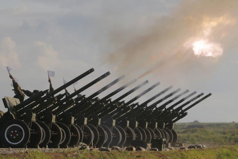 Russian guns are fired during a military salute outside Moscow.