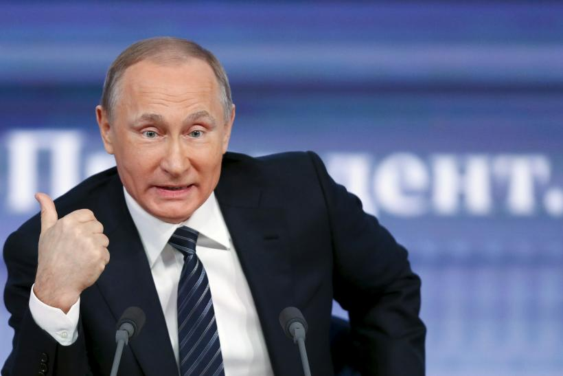 Russian president Vladimir Putin addresses journalists at a Moscow conference