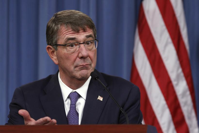 Pentagon chief Ash Carter gestures during a press conference