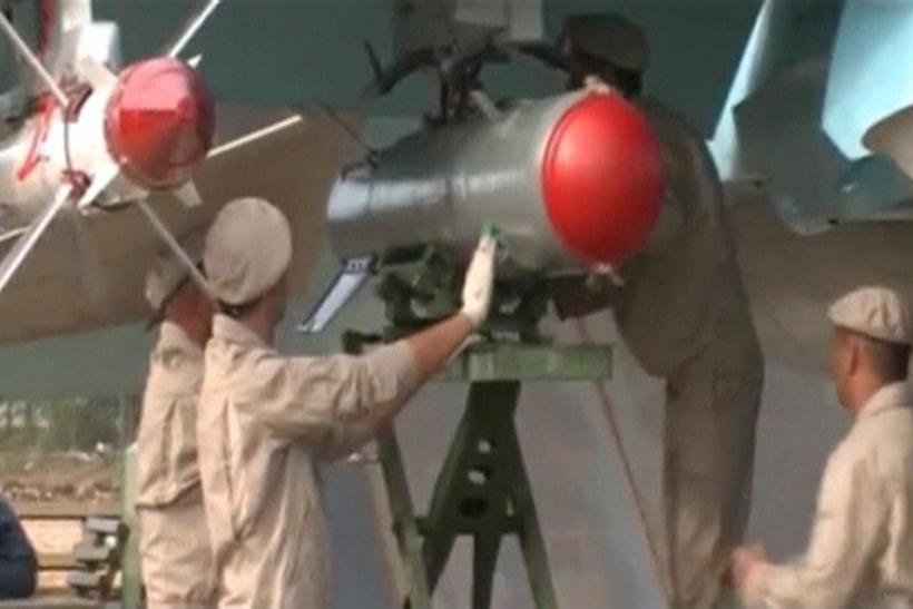 Russian engineers working on an aircraft in Syria