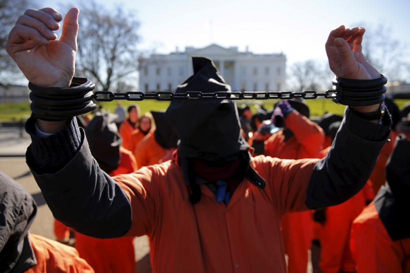 A protester dressed as a Gunatanamo Bay detainee in front of the White House.