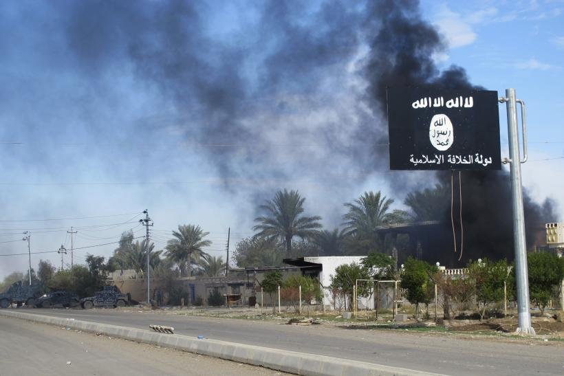 An ISIS flag near a road in Iraq.