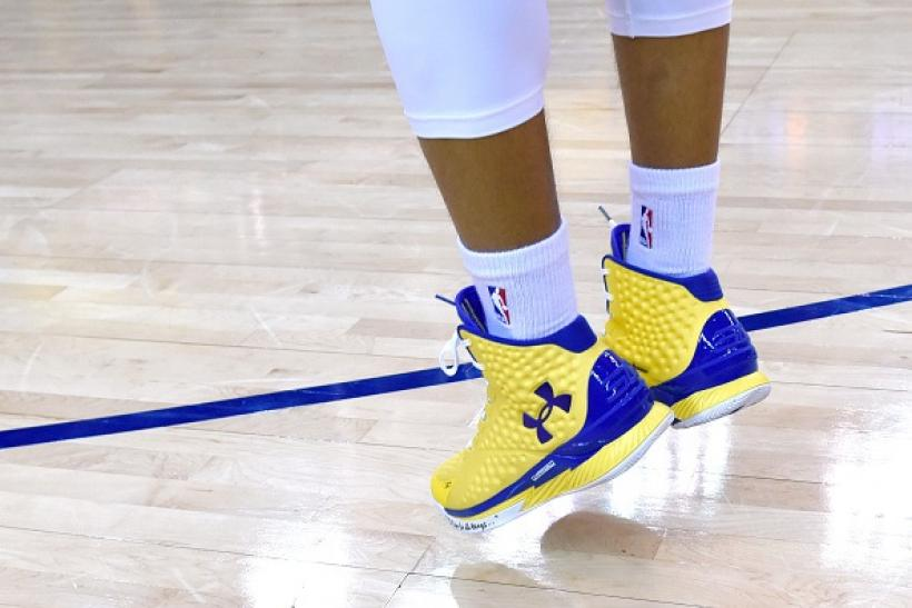 a9ef5ba4e21 The Under Armour Curry One shoes worn by Stephen Curry of the Golden State  Warriors are seen as he warms up for an NBA basketball game in Oakland