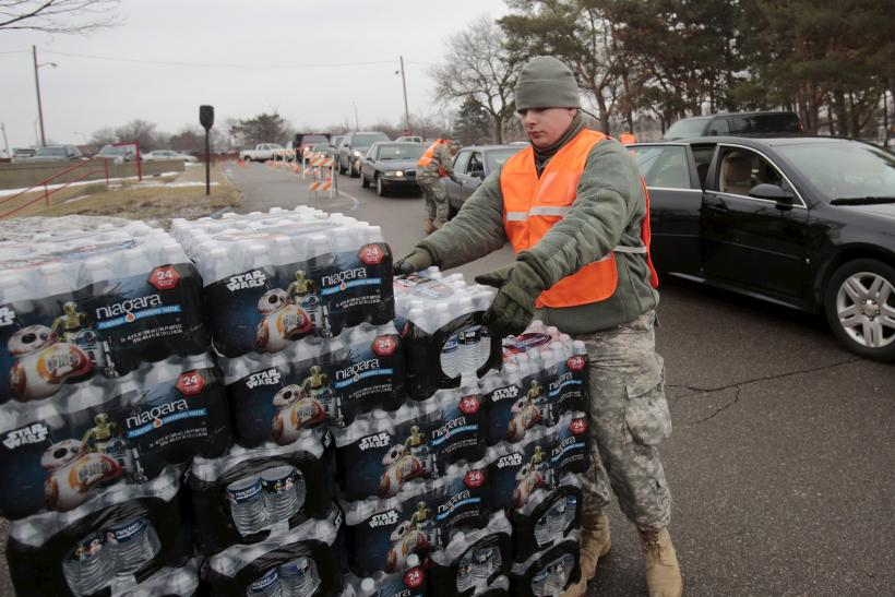 A National Guard member helps distribute water in Flint, Michigan.