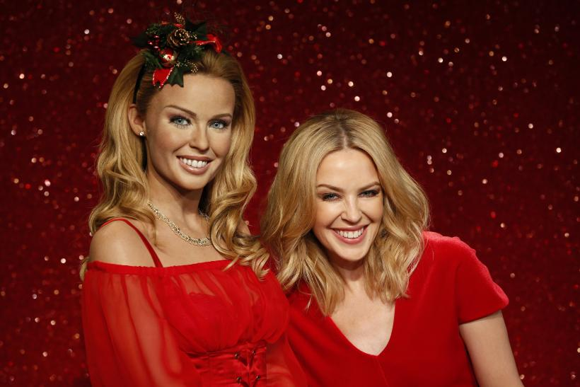 Australian singer Kylie Minogue poses with her wax figure