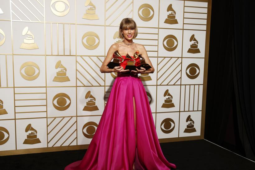 Singer Taylor Swift poses with her Grammy Awards