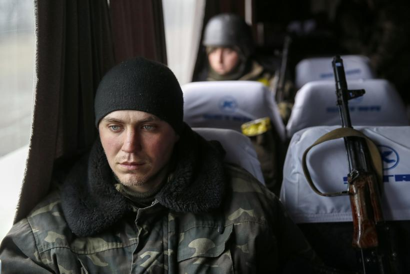 A Ukrainian serviceman sits on a bus before returning home.