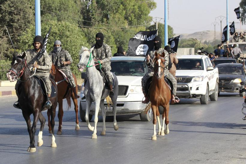 ISIS fighters ride horses during a parade in Raqqa, Syria.