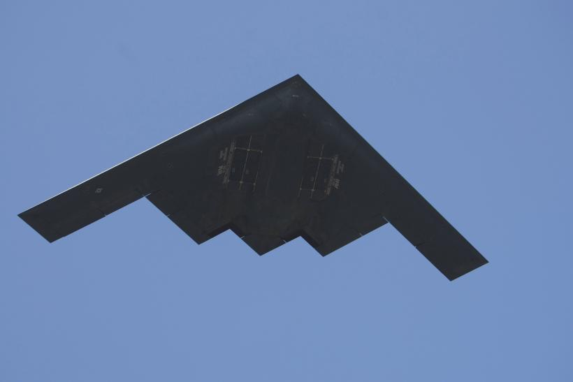 A B-2 Spirit bomber flies over the 95th Rose Bowl game.