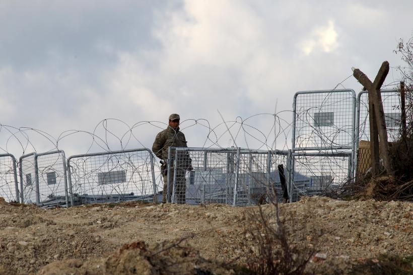 A Turkish soldiers stands guard on the Syrian border.