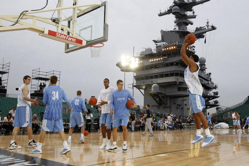 North Carolina players warm up ahead of a game onboard the USS Carl Vinson.
