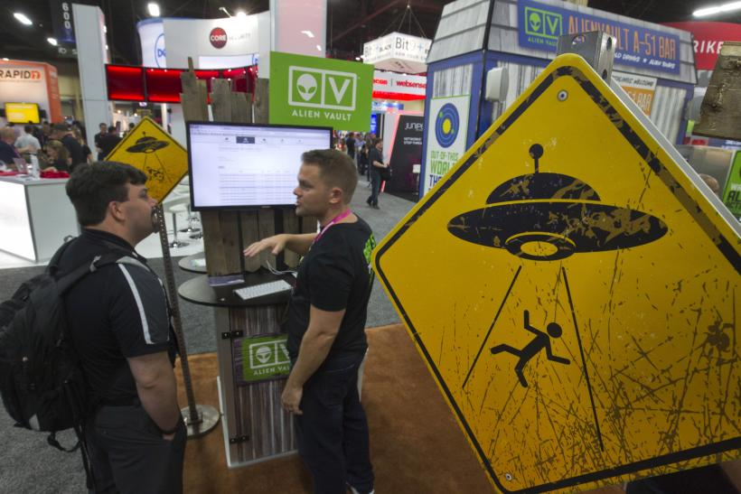 A sign shows a person being abducted by aliens.