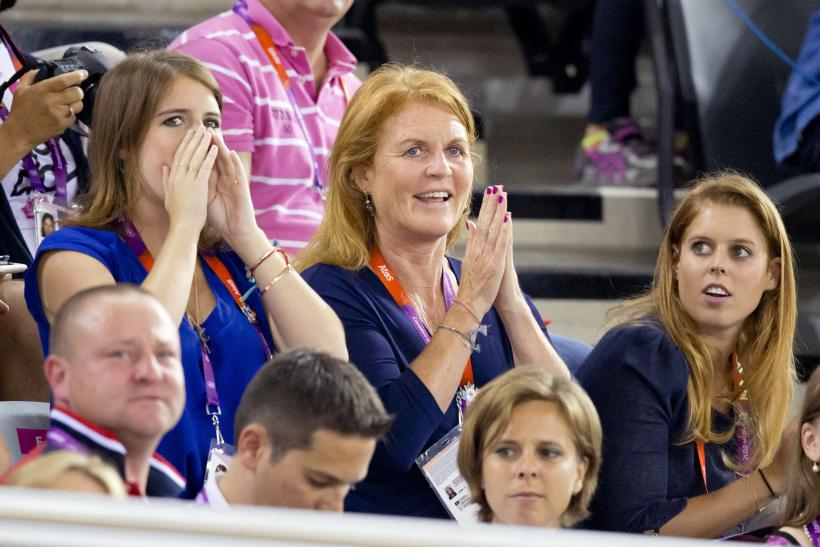 Sarah Ferguson (C) along with her daughters Princess Eugenie (L) and Princess Beatrice