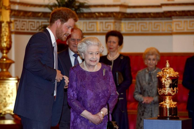Prince Harry (L) and Queen Elizabeth