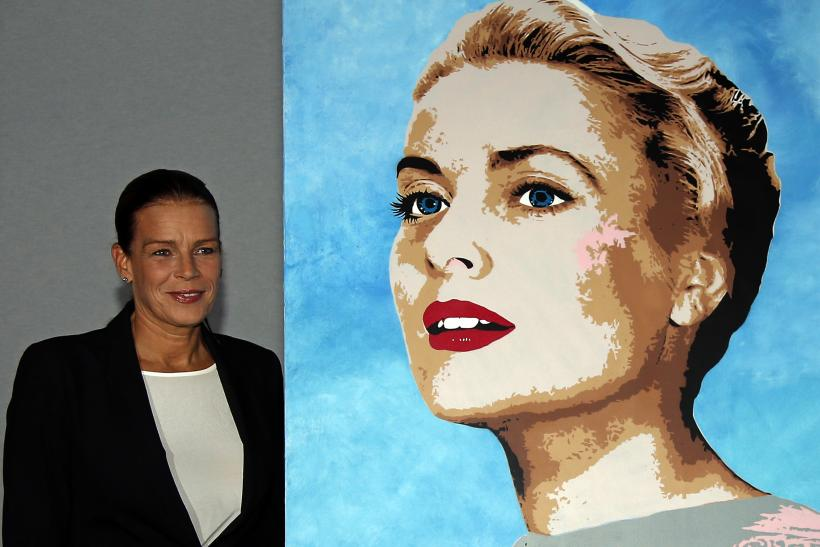 Princess Stephanie of Monaco (L), president of Fight Aids Monaco, poses next to a painting of her mother Princess Grace