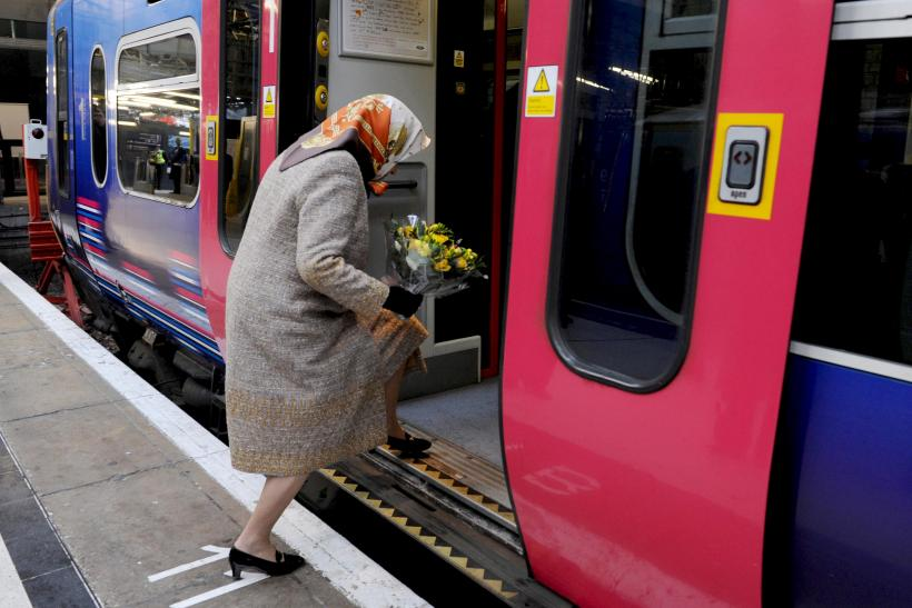 Britain's Queen Elizabeth boards a train at Kings Cross station
