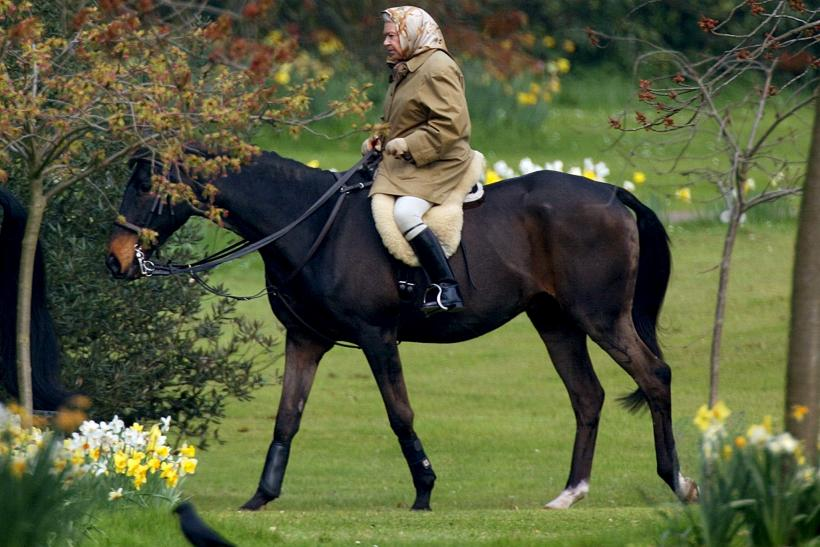 Britain's Queen Elizabeth rides her horse in the grounds of Windsor Castle