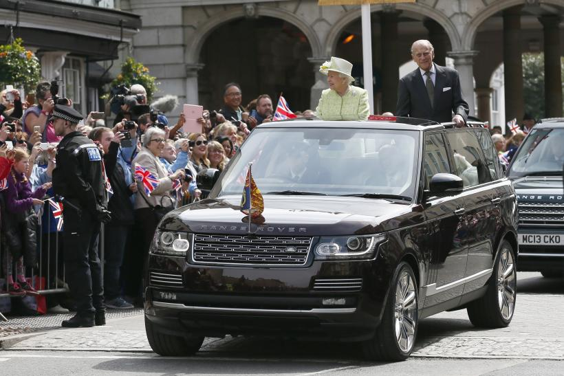 Britain's Queen Elizabeth is driven past well wishers on her 90th birthday with Prince Philip