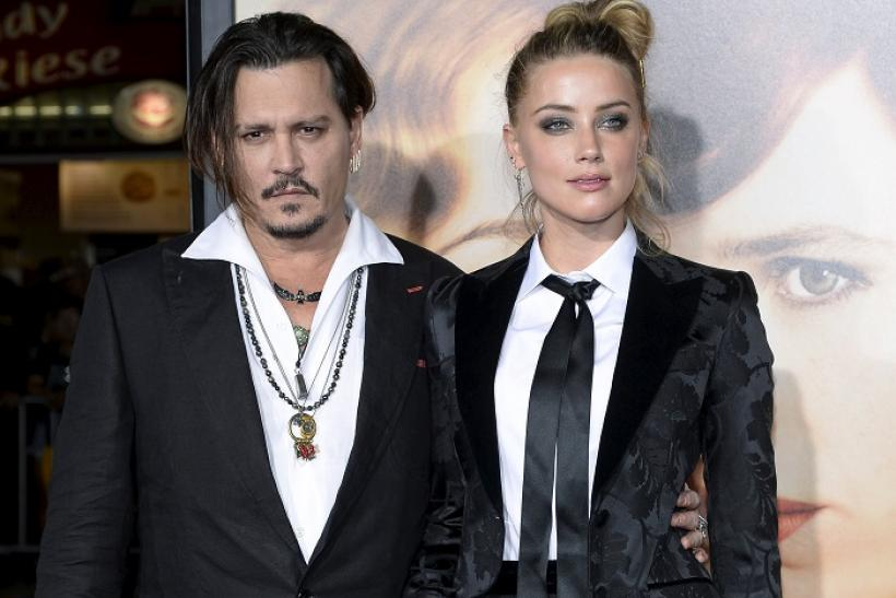 Amber Heard (R) and Johnny Depp