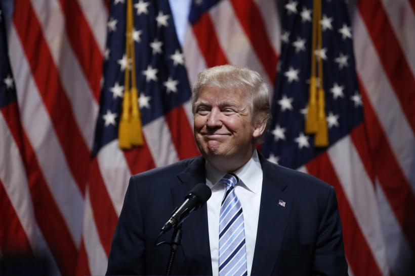 b8d50ef4e Republican U.S. presidential candidate Donald Trump pauses as he speaks  before introducing Indiana Governor Mike Pence as his vice presidential  running mate ...