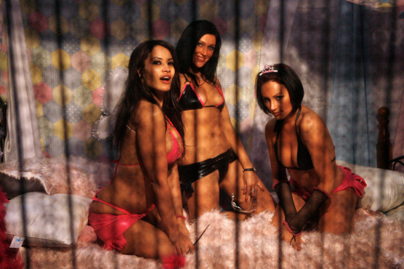 Models wait to take photos with customers during the opening day of the annual Sexpo in Sydney July 24, 2008.