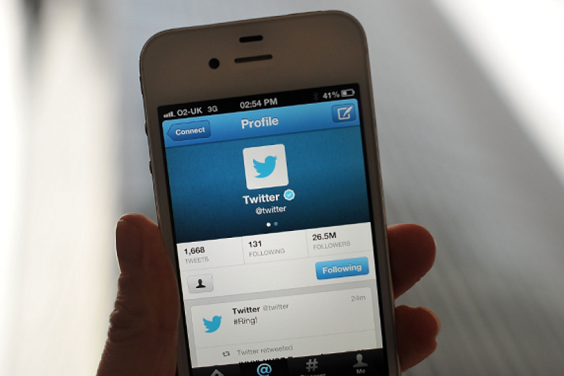 Twitter logo and hashtag '#Ring!' is displayed on a mobile device as the company announced its initial public offering and debut on the New York Stock Exchange on November 7, 2013 in London, England.