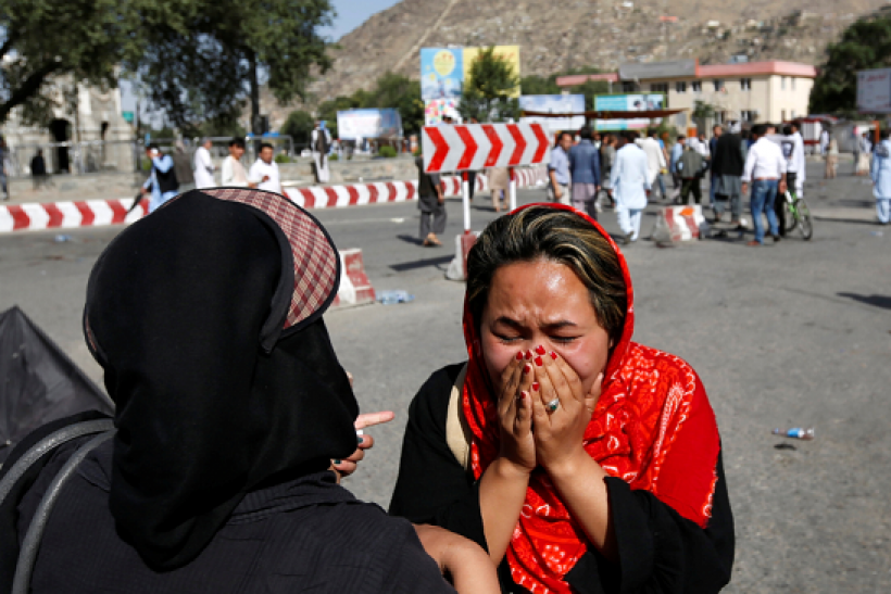 An Afghan woman weeps at the site of a suicide attack in Kabul, Afghanistan July 23, 2016.