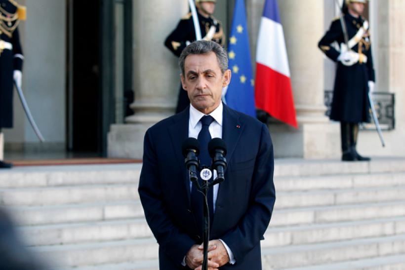 Former French President Nicolas Sarkozy talks to the medias after a meeting with French President Francois Hollande at the Presidential Elysee Palace on November 15, 2015 in Paris, France