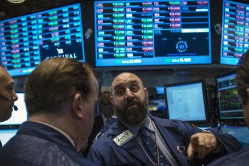 Traders work on the floor of the New York Stock Exchange, Oct 3, 2013.