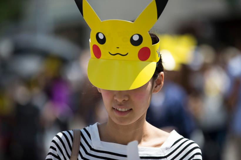 A woman wearing a Pikachu shaped sun visor arrives for the Pikachu Outbreak event hosted by The Pokemon Co. Aug. 7 2016 in Yokohama Japan. & Pokémon GO Halloween Costume Ideas For Adults: 5 Easy Ways To Dress ...
