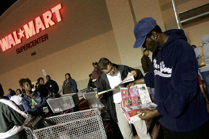gettyimages 56272098 shoppers are shown outside a walmart store