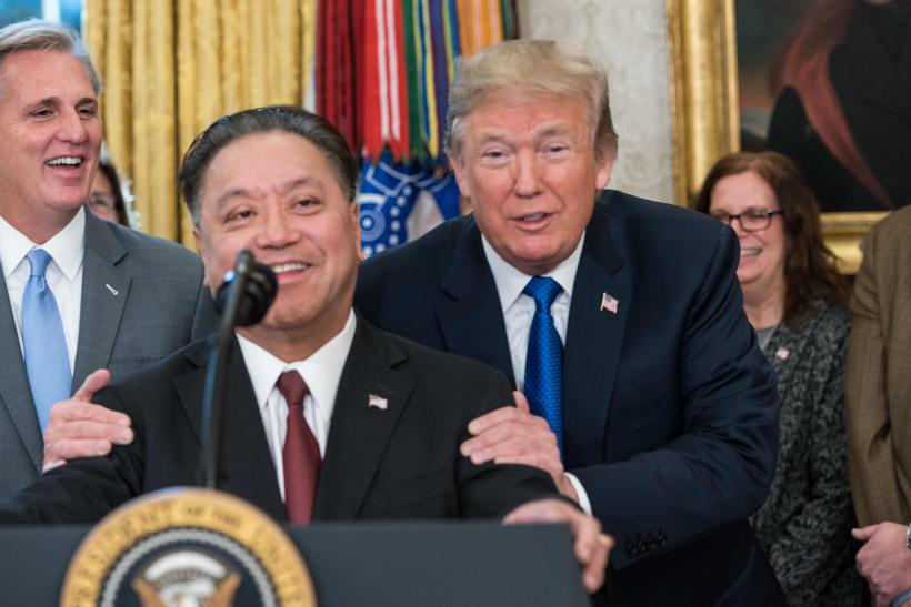 US President Donald Trump jokes with Broadcom CEO Hock Tan