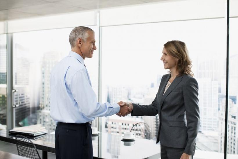 professionals-shaking-hands_gettyimages-107430233_large