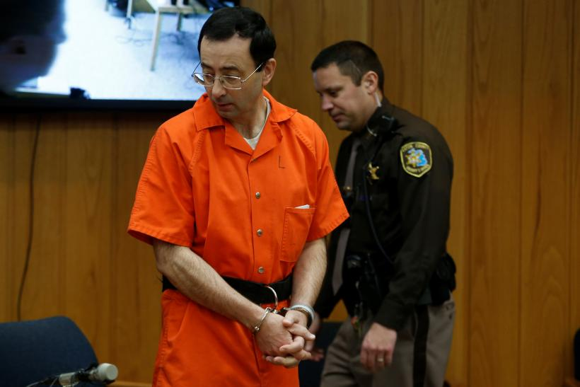 Image result for Larry Nassar, a former team USA Gymnastics doctor who pleaded guilty in November 2017 to sexual assault charges, stands in court during his sentencing hearing in the Eaton County Court in Charlotte, Michigan, U.S., February 5, 2018.