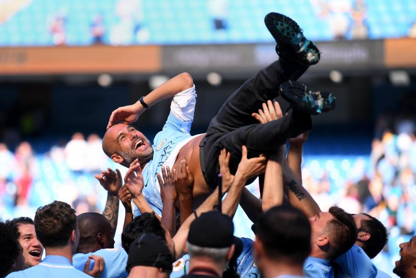Guardiola extends City stay after record-breaking season