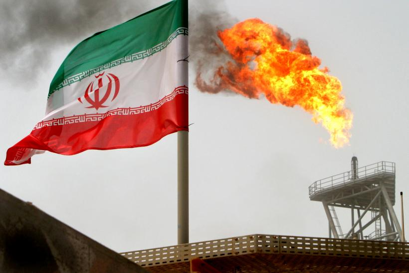 iranA gas flare on an oil production platform in the Soroush oil fields is seen alongside an Iranian flag in the Persian Gulf, Iran, July 25, 2005. REUTERS/Raheb Homavandi/File Photo