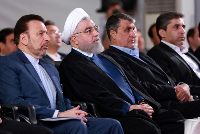 A handout picture provided by the Iranian presidency on August 27, 2019, shows President Hassan Rouhani (2 L) attending a ceremony in the capital Tehran