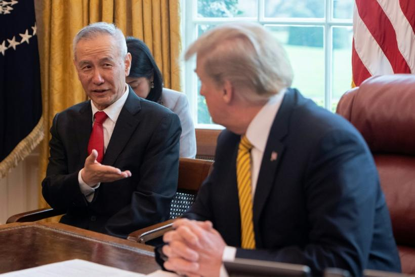 China's Vice Premier Liu He (L) speaks with US President Donald Trump during a trade meeting in the Oval Office at the White House in Washington in April 2019