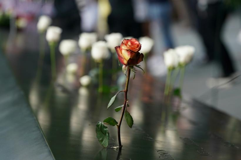 People leave flowers during the September 11 Commemoration Ceremony at the 9/11 Memorial at the World Trade Center on September 11, 2019,in New York.