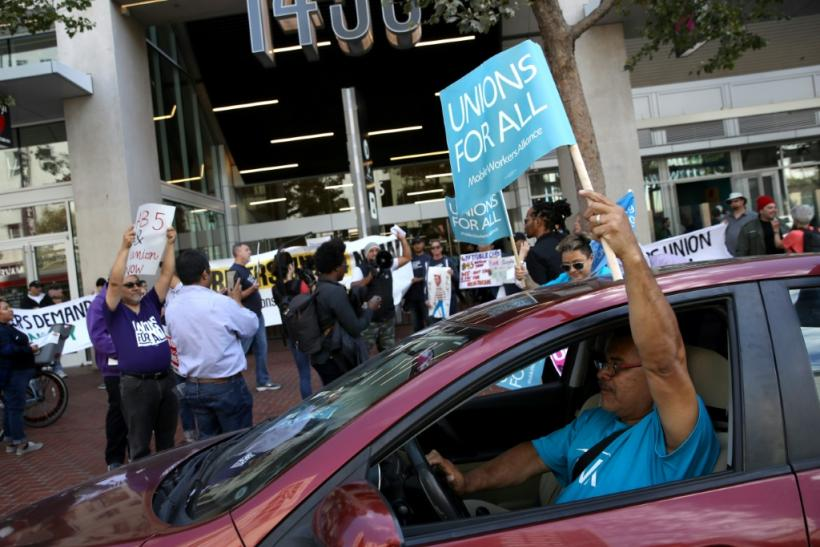 Rideshare drivers rallied on August 27 in support of California law to require firms such as Uber and Lyft to treat them as employees instead of independent contractors