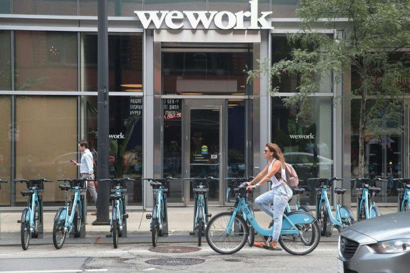 WeWork's parent The We Company intends to move forward on a share listing this month, according to sources, after making changes to its governance structure