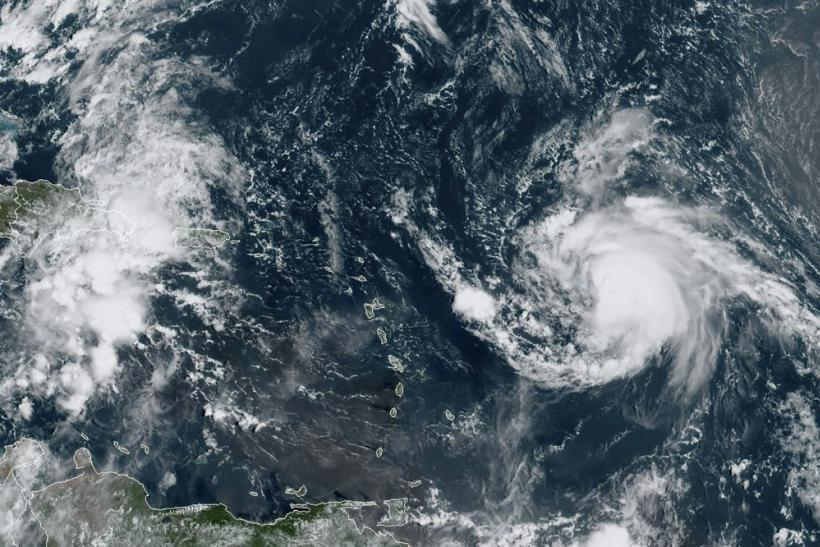 Hurricane Jerry swirls in the Atlantic on September 19 in this satellite image obtained from NOAA/RAMMB