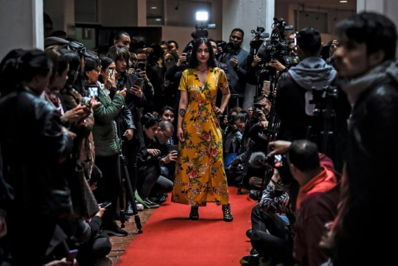 A model shows off a kimono during a fashion show by former FARC combatants in Bogota