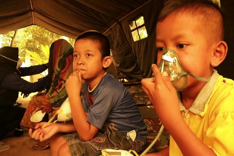 Indonesian children get a dose of oxygen from a Red Cross volunteer. UNICEF says the forest fires are puttling nearly 10 million children at risk from the toxic air
