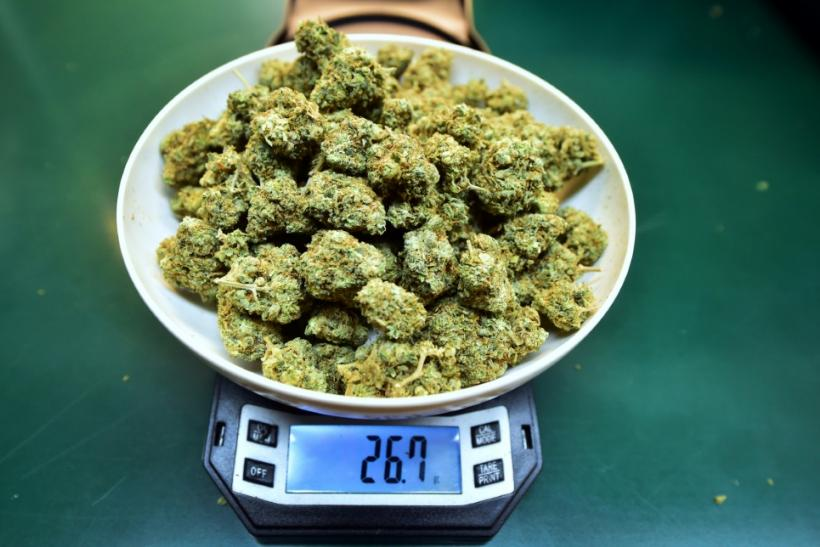 Marijuana buds are weighed at a dispensary in Los Angeles