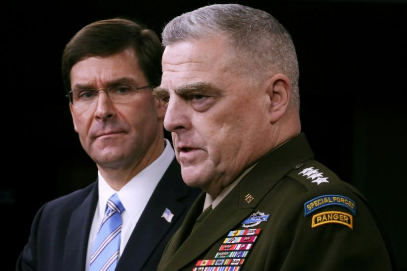 US Defense Secretary Mark Esper (L) and Chairman of the Joint Chiefs of Staff Gen. Mark Milley discuss the raid that killed Islamic State group head Abu Bakr al-Baghdadi
