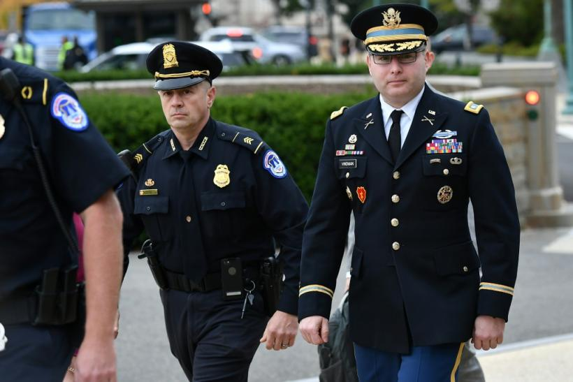 Lieutenant Colonel Alexander Vindman (R), a White House National Security Council Ukraine expert, arrives at Congress to testify in the impeachment inquiry against President Donald Trump